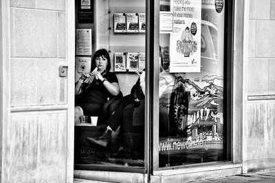 Woman waiting at a bank
