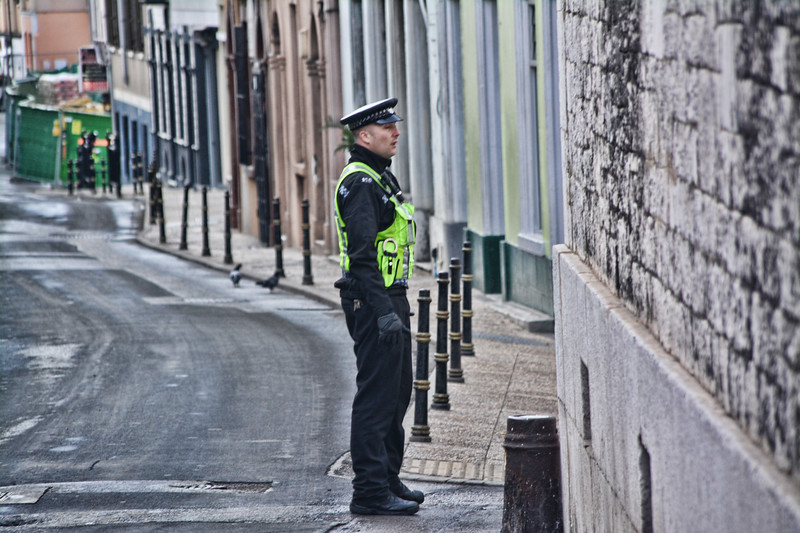 Police watches road after it is  evacuated following a Bomb disposal unit operation in Gibraltar