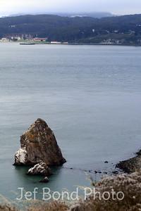 Vertical image of Sea Rock below Golden Gate Bridge