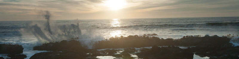 The sun sets as the tide rolls in and unleashes its enery on the rocks.