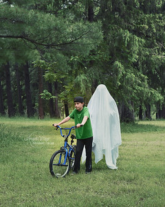 Boy with Bike and Scary Ghost in Woods