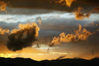 Golden clouds, black mountains