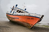 Posterized image of a beached fishing boat, Chiloe Island, Chile