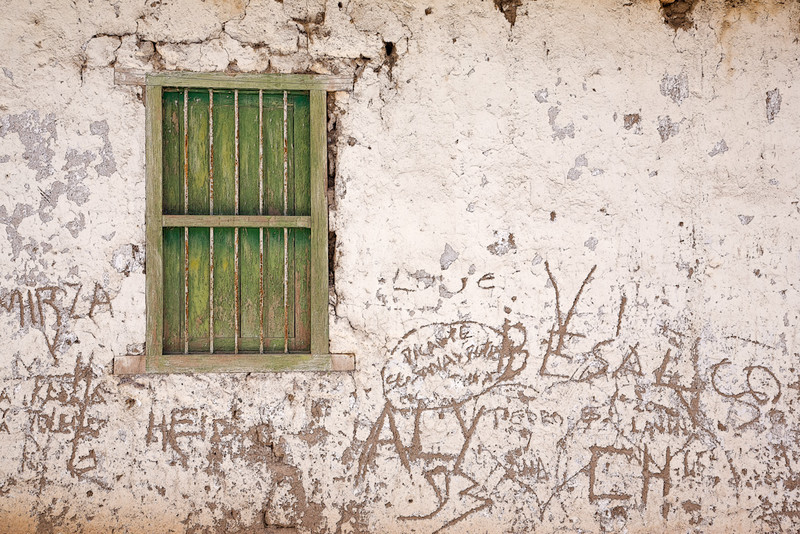 Belen, Chile, shuttered window and scratched graffiti.