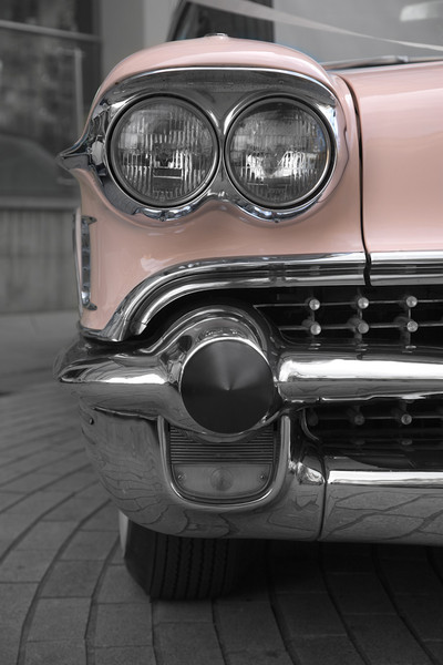 De-saturated image of a pink cadillac (detail)
