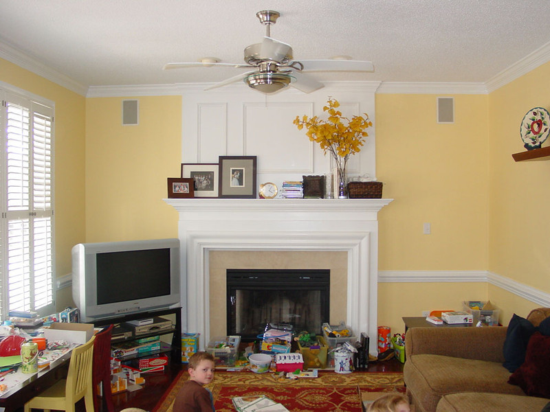 "BEFORE PICTURE.<br /> Look at those toys and books that need a new home.<br /> <br /> ""What if you bought a flat screen TV and put it over the mantle?"""