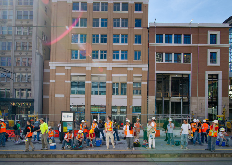 Construction workers wait for light-rail in Salt Lake City Utah near City-Creek, a new development the LDS Church.
