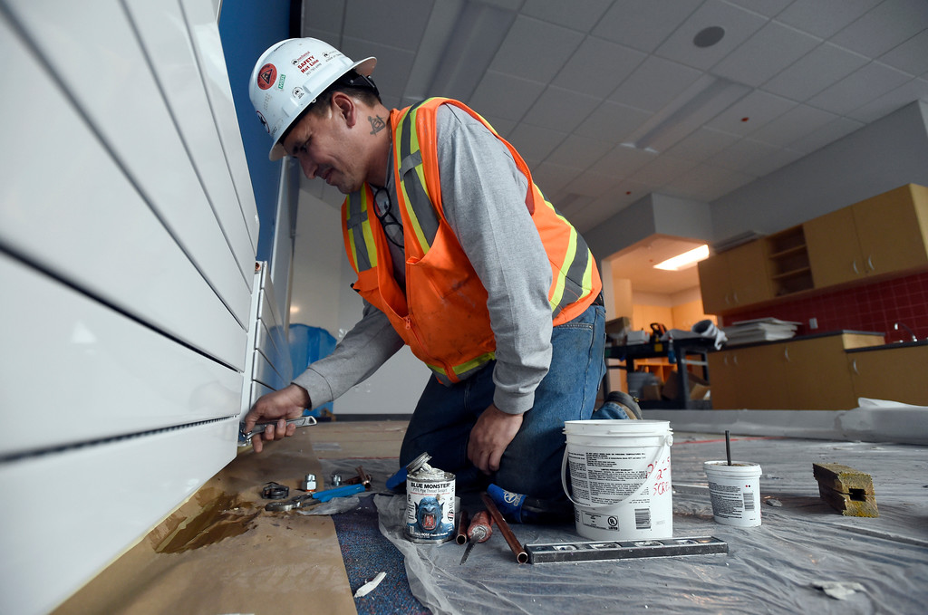 . Adam Gutierrez, with RK Mechanical, works on a new wall mount heater in one of the classrooms while doing construction at Creekside Elementary School on Tuesday in Boulder. For more photos of the construction go to www.dailycamera.com Jeremy Papasso/ Staff Photographer/ May 16, 2017
