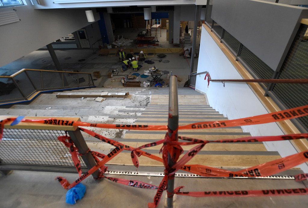. Crews work to install floor tiles in the main gathering area while doing construction on Creekside Elementary School on Tuesday in Boulder. For more photos of the construction go to www.dailycamera.com Jeremy Papasso/ Staff Photographer/ May 16, 2017