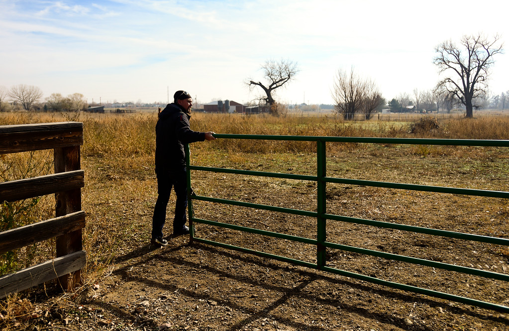 . Chris Davidson opens a gate to a pasture on his property near Erie in Colorado on Nov. 10, 2017. Crestone Peak Resources is planning to drill up to 36 wells on a pad on Boulder County Open space that backs to Davidson\'s property.  (Photo by Matthew Jonas/Times-Call)