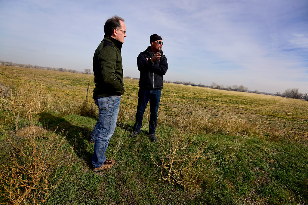 . Chris Davidson, right, and Karl Volz, left, stand near Boulder County Open Space property in Colorado on Nov. 10, 2017. Crestone Peak Resources is planning to drill up to 36 wells on a pad on Boulder County Open Space that backs to Davidson\'s property and is near Volz\'s property. (Photo by Matthew Jonas/Times-Call)