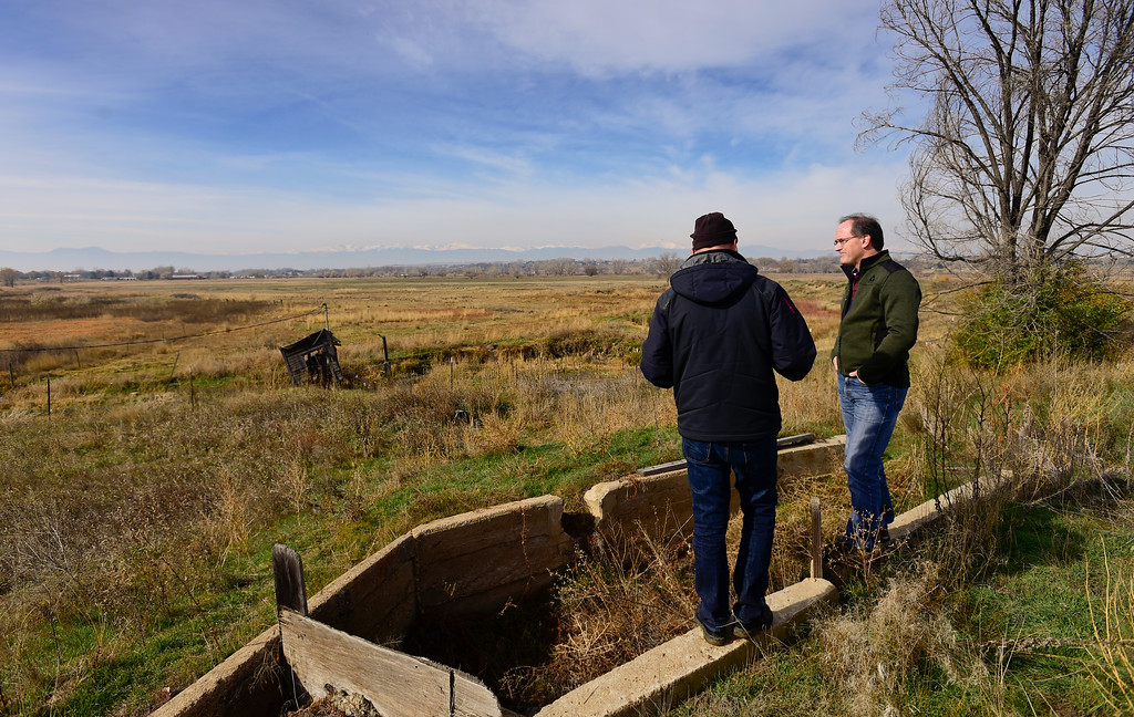 . Chris Davidson, left, and Karl Volz, right, look out over a flood plane and irrigation ditches while standing near Boulder County Open Space property in Colorado on Nov. 10, 2017. Crestone Peak Resources is planning to drill up to 36 wells on a pad on Boulder County Open Space that backs to Davidson\'s property and is near Volz\'s property. (Photo by Matthew Jonas/Times-Call)