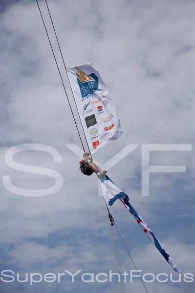 Crew tying flags