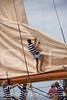 Hoisting the mainsail on Lulworth