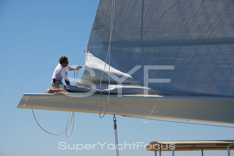 Crew flaking the mainsail