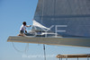 Crew flaking the mainsail