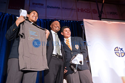A representative from RSM, a tax and audit company in Dallas, draft freshman Pamely Shah, at left, and Christian Cazares during Draft Day July 28 at Cristo Rey Dallas College Preparatory School.