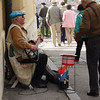 Street musician with checkered hat.  The Croatian flag has checkers on it, as does the Croatian soccer team.