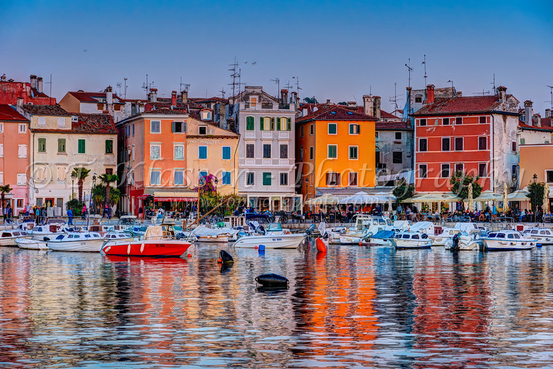 Colorful buildings and the village skyline at sunset with pleasure and fishing boats at Rovinj, Croatia, Istria.