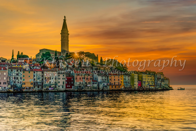 The village skyline and the Adriatic Sea at sunset at Rovinj, Croatia, Istria.