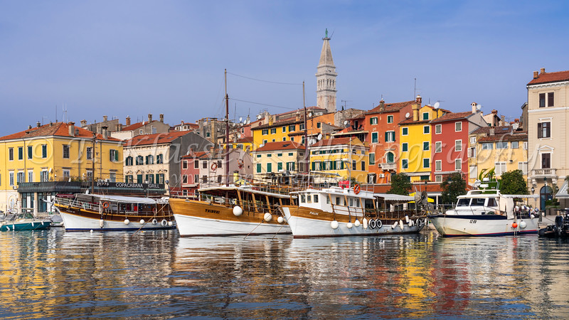 Colorful buildings and the village skyline with pleasure and fishing boats at Rovinj, Croatia, Istria.