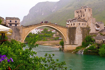 Stari Most (English: Old Bridge) is a 16th century Ottoman bridge in the city of Mostar, Bosnia and Herzegovina that crosses the river Neretva and connects two parts of the city. The Old Bridge stood for 427 years, until it was destroyed on November 9, 1993 during the Croat-Bosniak War. Subsequently, a project was set in motion to reconstruct it, and the rebuilt bridge opened on July 23, 2004.