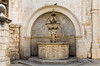 An abandoned outdoor water fountain in the historic old city of Dubrovnik, Croatia.
