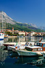 The harbour with a waterfront walk and fishing boats in Makarska, Croatia.