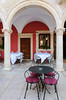 An outdoor restaurant with table setting and arches in Sibenik, Croatia.