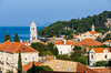 The Croatian fiahing village of Cavtat with church steeple and harbour.