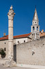 The bell tower of the St. IIia church and a Roman column in Zadar, Croatia.