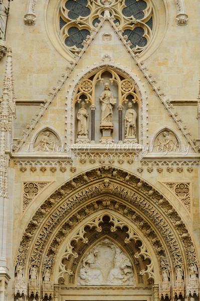An ornate front entrnce door to the church of the Assumption of the Virgin Mary in Zagreb, Croatia.