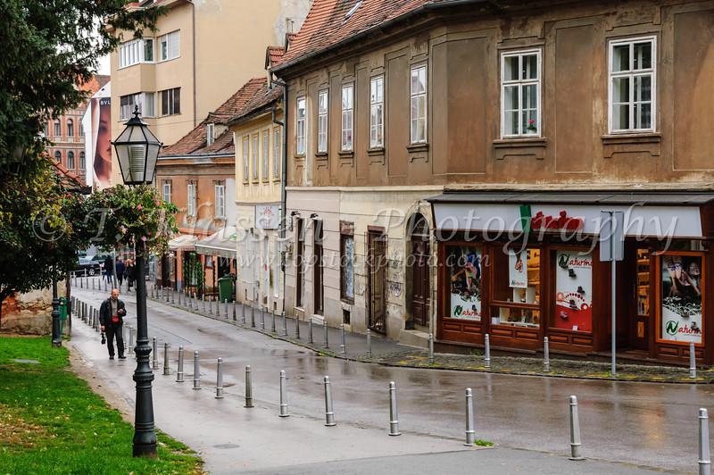 A street scene of Zagreb, Croatia on a rainy day.