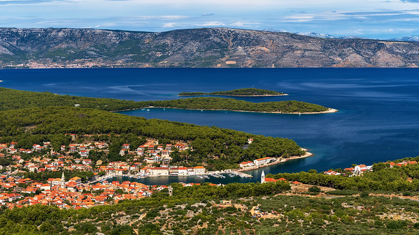 City Jelsa on island hvar and view of island Brac with city Bol in the background