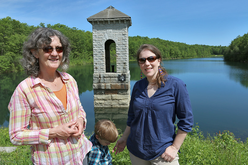 Jassy Bratko the director of land protection with the North County Land Trust, Inc., Anna Wilkins the executive director with NCLT and Van Wilkins, 4, at the Crocker Conservation Area in Fitchburg. SENTIENL & ENTERPRISE/JOHN LOVE