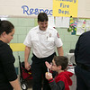 "Crocker Elementary School hosted its first annual ""Fuel Up to Play 60"" Health Fair on Thursday night at the school. Fitchburg Fire Lt. Phil Jordan chats with the many people that came their booth in the cafeteria at the event. SENTINEL & ENTERPRISE /JOHN LOVE"