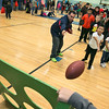 "Crocker Elementary School hosted its first annual ""Fuel Up to Play 60"" Health Fair on Thursday night at the school. Richard Gonzalez with Leominster Pop Warner helps third grader Benjamin Lor, 8, with his football toss at one of the stations at the event. With Lor is his sister Ava, 5, and mom Sue Nang. SENTINEL & ENTERPRISE /JOHN LOVE"