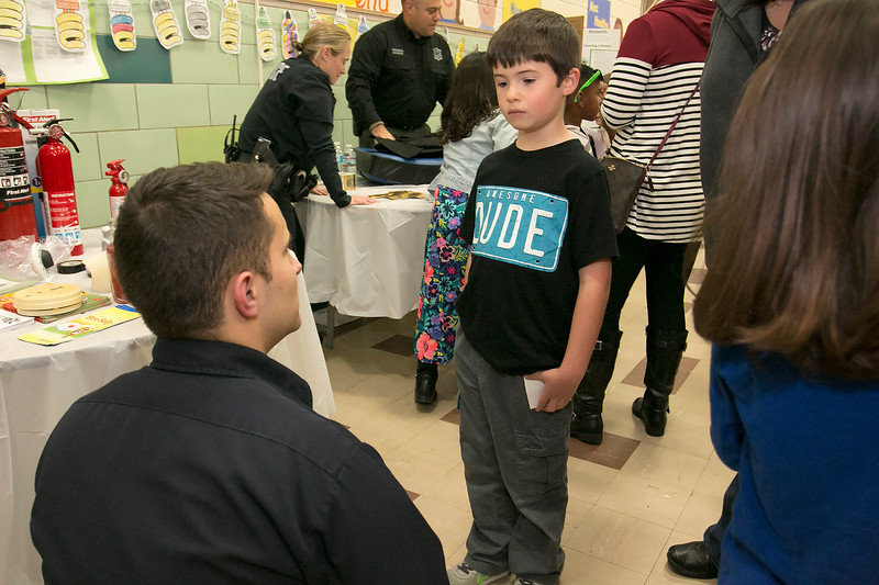 """Crocker Elementary School hosted its first annual """"Fuel Up to Play 60"""" Health Fair on Thursday night at the school. Fitchburg Firefighter Nick Landry chats with Ryan MacDonald, 7, about fire safty at their booth at the event. SENTINEL & ENTERPRISE /JOHN LOVE"""