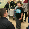 "Crocker Elementary School hosted its first annual ""Fuel Up to Play 60"" Health Fair on Thursday night at the school. Fitchburg Firefighter Nick Landry chats with Ryan MacDonald, 7, about fire safty at their booth at the event. SENTINEL & ENTERPRISE /JOHN LOVE"