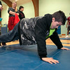 "Crocker Elementary School hosted its first annual ""Fuel Up to Play 60"" Health Fair on Thursday night at the school. Fifth grader Malachi Herbert, 11, does some pushups at one of the health stations in the gym at the event. SENTINEL & ENTERPRISE /JOHN LOVE"
