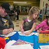 "Crocker Elementary School hosted its first annual ""Fuel Up to Play 60"" Health Fair on Thursday night at the school. Paul Marklund and his daughters Abby , 4, and Sophie, 8, did some coloring in the cafeteria at the event. SENTINEL & ENTERPRISE /JOHN LOVE"