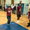 "Crocker Elementary School hosted its first annual ""Fuel Up to Play 60"" Health Fair on Thursday night at the school. fitchburg High School football players Angel Crespo and Joseph Maye watch as Chase Callahan, 8, does some jumping jacks at their health station in the gym at the event.  SENTINEL & ENTERPRISE /JOHN LOVE"