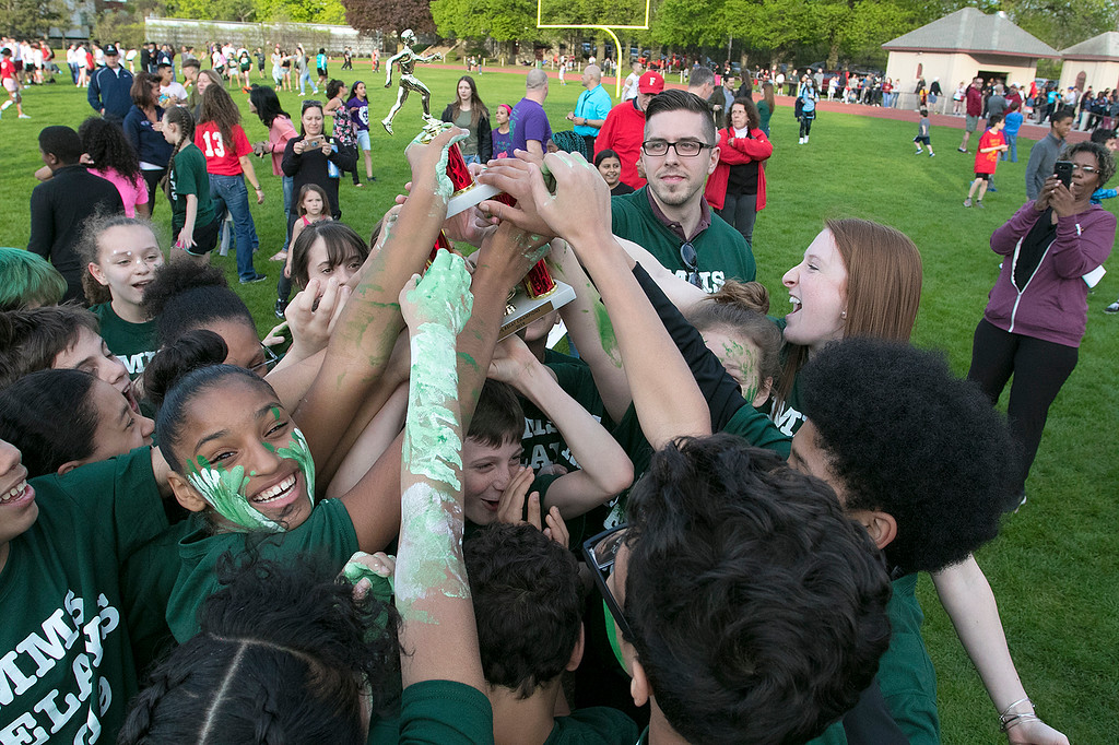 . The 105th running of the Fitchburg Schools Relays were held at Crocker Field Thursday, May 16, 2019. Athletes from Fitchburg Public Schools run against one another (school vs. school, class vs. class). Sixth graders from Memorial Middle School celebrate their victory. SENTINEL & ENTERPRISE/JOHN LOVE
