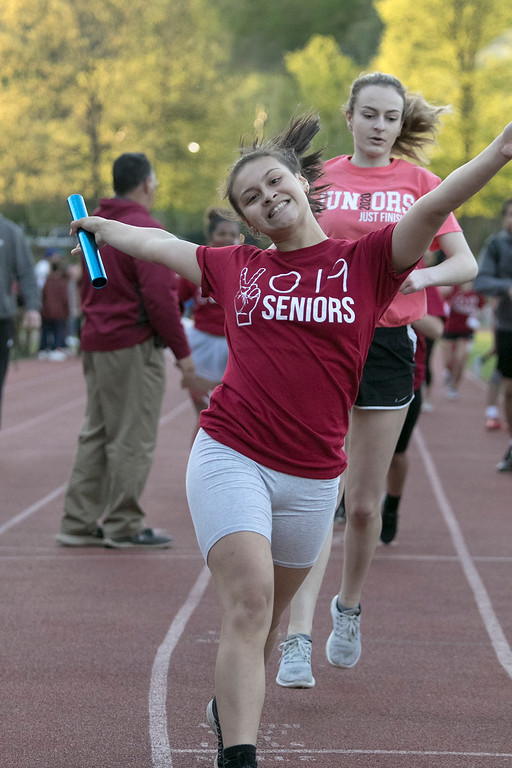 . The 105th running of the Fitchburg Schools Relays were held at Crocker Field Thursday, May 16, 2019. Athletes from Fitchburg Public Schools run against one another (school vs. school, class vs. class). Senior Jesmary Melendez celebrates after crossing the finish line for the win over the junior class. SENTINEL & ENTERPRISE/JOHN LOVE