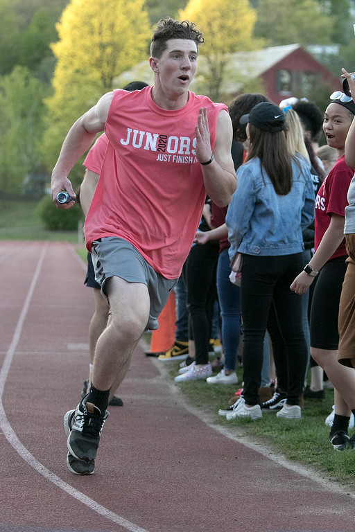 . The 105th running of the Fitchburg Schools Relays were held at Crocker Field Thursday, May 16, 2019. Athletes from Fitchburg Public Schools run against one another (school vs. school, class vs. class). Senior Dohnavan LeBlanc competes in the junior vs senior relay. SENTINEL & ENTERPRISE/JOHN LOVE
