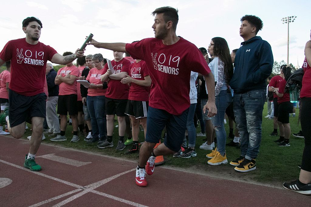 . The 105th running of the Fitchburg Schools Relays were held at Crocker Field Thursday, May 16, 2019. Athletes from Fitchburg Public Schools run against one another (school vs. school, class vs. class). Senior Carlos Figueroa hands the baton to senior William Carrizo during their race against the juniors. SENTINEL & ENTERPRISE/JOHN LOVE