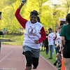 The 105th running of the Fitchburg Schools Relays were held at Crocker Field Thursday, May 16, 2019. Athletes from Fitchburg Public Schools run against one another (school vs. school, class vs. class). Longsjo's eighth grader Tanila Council holds her arm up in salute to her teams victory as she crosses the finish line for the win during the relays. SENTINEL & ENTERPRISE/JOHN LOVE
