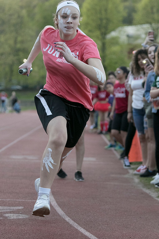 . The 105th running of the Fitchburg Schools Relays were held at Crocker Field Thursday, May 16, 2019. Athletes from Fitchburg Public Schools run against one another (school vs. school, class vs. class). Junior Madyson Jarrett takes off to start the Junior vs senior race. SENTINEL & ENTERPRISE/JOHN LOVE