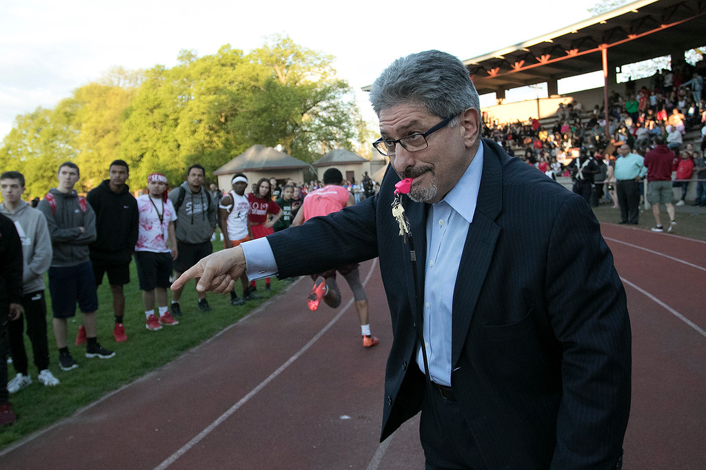 . The 105th running of the Fitchburg Schools Relays were held at Crocker Field Thursday, May 16, 2019. Athletes from Fitchburg Public Schools run against one another (school vs. school, class vs. class). Fitchburg Mayor Stephen DiNatale blows the whistle to start the junior vs senior race. SENTINEL & ENTERPRISE/JOHN LOVE