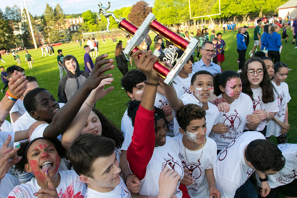 . The 105th running of the Fitchburg Schools Relays were held at Crocker Field Thursday, May 16, 2019. Athletes from Fitchburg Public Schools run against one another (school vs. school, class vs. class). Longsjo students celebrate their victory. SENTINEL & ENTERPRISE/JOHN LOVE